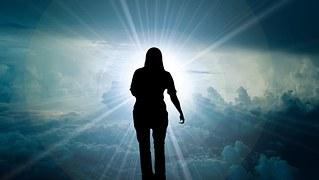 A woman walks toward the light.